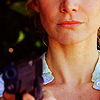 seven: The lower half of Juliet's face, with trademark smirk. She is holding a gun, blurry in the foreground. (Lost: Oh that smirk.)