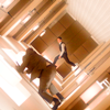 celestine_fics: A scene from the movie Inception with a revolving hallway and characters moving in it (Movies - Inception - Revolving Hallway)