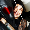 anotherslashfan: frank iero grinning, with heart icon (fandom love with frank)