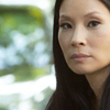 lizbee: Lucy Liu, with an ambiguous smile on her face (TV: Joan Watson)