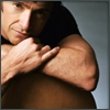 highlander_ii: Hugh Jackman leaning against the back of a chair, his chin resting on his arms ([VH] leaning on chair)