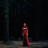 feuille: girl in red in middle of dark forest (girl in red)