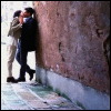 feuille: two people making out against a wall (makeout in alley)