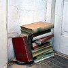 horusporus: A stack of books on the floor by a door. (books)