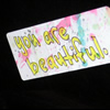 "metawidget: Sticker saying ""you are beautiful"" on a black background. (beautiful)"