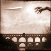mayhap: a hand launches a paper plane over an aqueduct (travels)