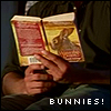 mayhap: closeup of Sawyer reading Watership Down with text Bunnies! (bunnies!)