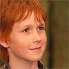 sebastard: a redheaded boy smiles. (bitty smile)