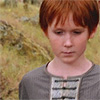 sebastard: a redheaded boy looks away from the camera. (bitty sadfais)