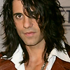 magic_fratboy: (smile - rock star hair / smirky)