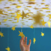 juniperphoenix: Stars dangling from the ceiling, and a hand reaching for them (Stars (not the ceiling))