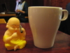 zirconium: photo of squeezy Buddha on cell phone, next to a coffee mug (buddha and cocoa)