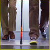 highlander_ii: House and Wilson's feet as they step off the elevator with House's new flame cane between them ([H&W] with the new cane)