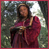 camp_victory: photo of young woman in renaissance gown with crossbow (becca)