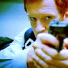 ladyvyola: Charlie Crews in flack jacket with gun (hard case)