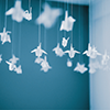 ofearthandstars: Paper cranes hanging from a blue ceiling (cranes)