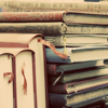 ofearthandstars: Stack of old, dusty books. (old books)