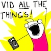 "thuviaptarth: woman with fistpump of triumph captioned ""VID ALL THE THINGS!"" (vid all the things!)"