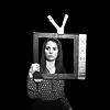 yourlongshadows: Annie Eddison framed by the card-board cutout of a TV. (CRISIS ALERT)