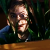 bluesuit_handy: (.misc | behind a plant)