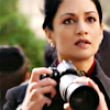 gavagai: Kalinda from The Good Wife, holding a long-lens camera and gazing at something in the distance (kalinda takes photos)