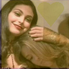 gamerchick: Kaylee resting her head on Inara's shoulder.  Both are smiling. (Inara/Kaylee)