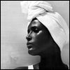 ext_20950: Black and white Waris Dirie in a white headwrap, shown in profile (headwraps yay)