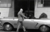 el_enmascarado_de_plata: Santo in a silver full face Spandex mask strolling up to a silver convertible (heading to the Santomobile (b&w))