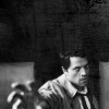 labellementeuse: grayscale icon. castiel reaches towards the camera. he looks grumpy. (spn castiel goes grrr)