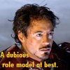 """artifactrix: Tony Stark in Iron Man armor (no helmet), disheveled and slightly bloody.  Captioned """"A dubious role model at best."""" (role model)"""
