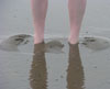 rainkatt: feet sunk in wet sand (beach: no toes)
