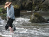 rainkatt: woman (me!) in dress and sunhat, wading in surf at beach (Default)