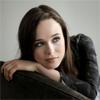 helens78: Ellen Page leaning on the back of a sofa. (rpf: ellen black jacket)