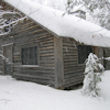 thothmes: The corner of a log cabin in deep snow. (Lodge in Winter)