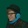 isweedan: Patrick doing press for the new album with headphones on upside down b/c hat. (Patrick with headphones)