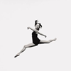 tree: a dancer in a black leotard, in the air mid-leap ([else] challenging gravity)