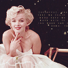 florianschild: Marilyn Monroe seated in front of a black backdrop (marilyn sit)