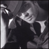 distractionary: Close-up on man in his 30s, smugly tipping a fedora. (at first I thought I couldn't)
