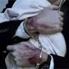 spatz: close-up Reese holding a baby with handcuffed, bloody wrists (POI Reese wrists baby)