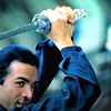 rhi: Duncan MacLeod, sword up and grinning (Duncan)