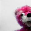 lizbee: A vivid pink bear against a grey background (TV: Pink bear)