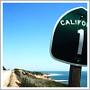 owlmoose: A photo of a Highway 1 roadsign, with the California Coast in the background (california - sign)