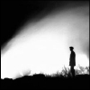 gramarye1971: a lone figure in silhouette against a blaze of white light (pensive)