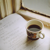frangipani: a mug of coffee standing on top of a document, next to a window (facing the morning)