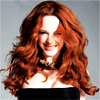 gorgeousnerd: Christina Hendricks, smiling, with shoulder-length red hair and a black strapless dress. (Christina Hendricks.)