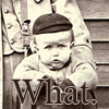 brigid: A fat faced baby in a cap is stuffed into a mail sack worn by a postal carrier. (what.)