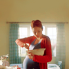 jenwryn: DW's Amy, pregnant, stiring a bowl in the kitchen. (doctor who • amy; pregnant and kitchen'd)