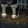 nex: Grungy black and white converse against a worn persian rug. (Default)