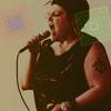 ajnabi: a fierce activist channels hir fury/passion into a microphone. (hear me roar)