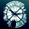 accountabilities: Two people standing in front of a large clock. (Time.)